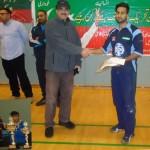 man of the series, omar hayat from the winning team kb receives a gift card from a sponsor of the tournament mr raja ghafoor afzal radio aap ki awaz.